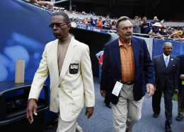 Gale Sayers and Dick Butkus walk onto the field before a Bears game
