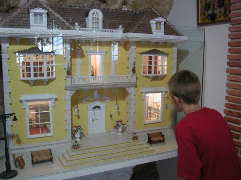 My other grandson looking at one of the many doll's houses