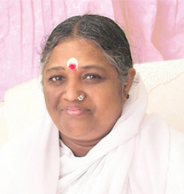 Amma - Mata Amritanandamayi, a living saint in whose presence miracles happen practically everyday.