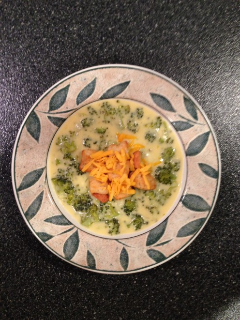 Thick and creamy cheddar broccoli soup  topped with garlic croutons and additional shredded cheddar cheese.