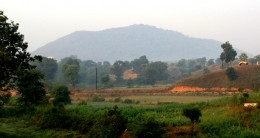 Kamad Giri Hill, which resembles a bow, is seen at a distance