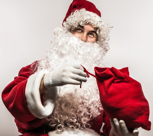 Old Saint Nick here in this picture is obviously thinking about which websites or box office to get his tickets from