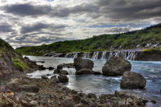 Hraunfossar - the Hraun rapids. Saga-land - e. Find them close to the Hallmundarhraun, near the Langjokull glacier in western Iceland,