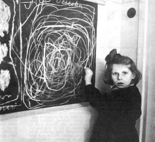 "POLAND. 1948. Teresa, a child in a residence for disturbed children, grew up in a concentration camp. She drew a picture of ""home"" on the blackboard."