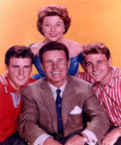 The Nelsons color photo: Standing, Harriet, from left, older Rick, Dave, Ozzie in front