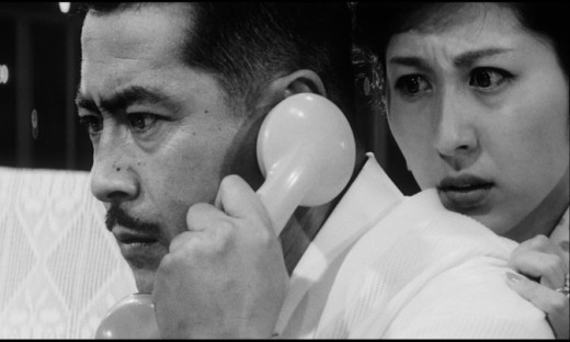 Gondo (Toshirō Mifune) and his wife (Kyōko Kagawa) play cat-and-mouse with an unseen kidnapper in Akira Kurosawa's High and Low (1963)