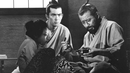 Dr. Niide (Toshirō Mifune, right) tries to feed the disturbed Otoyo (Terumi Niki, left) as Dr. Yasumoto (Yūzō Kayama) looks on in Akira Kurosawa's Red Beard (1965)