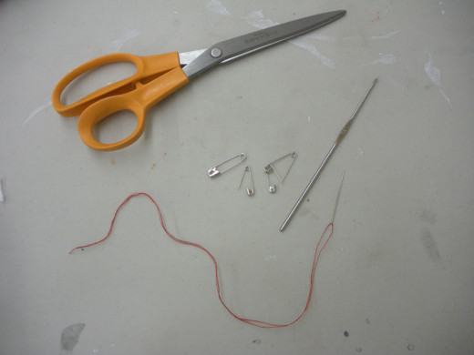 You will need scissors, safety pins, needle and thread, and a really fine crochet hook.  Don't worry; you don't need to know how to crochet.  It's only used for fishing thread or yarn through tight weaves.