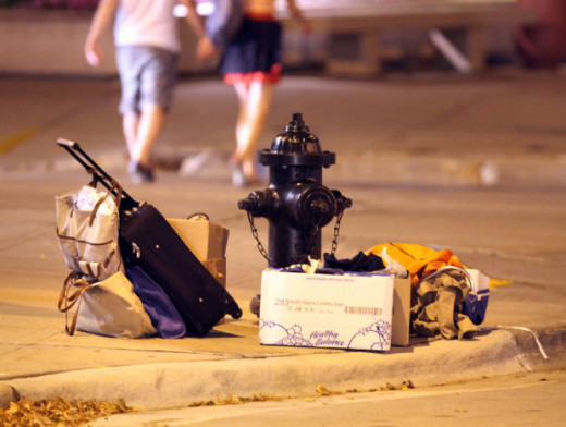 Personal belongings of a homeless person are left at intersection near the Madison Municipal Building on Martin Luther King Jr. Boulevard recently.
