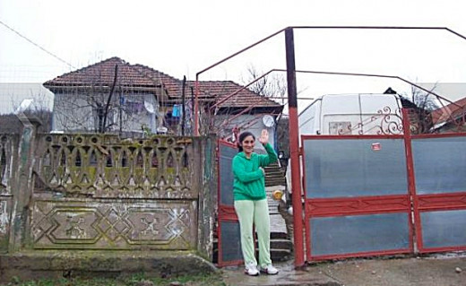 Maria Lazar in front of their new house