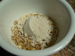 The oats, flour, and walnuts will be mixed together in a bowl.