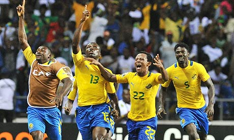 Bruno Zita Mbanangoye (13) points upward after scoring a goal against Morocco in a 2012 AFCON group stage match.