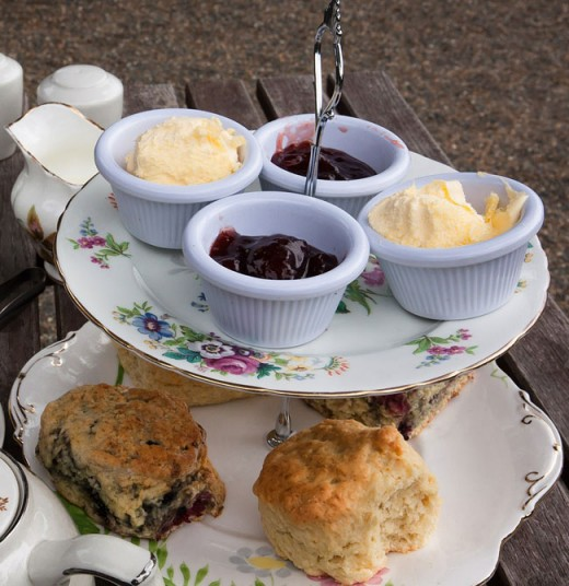 Scones with clotted cream and jam on a tiered serving plate