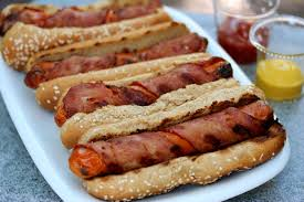 Here is another photo of delicious bacon wrapped hot dogs.