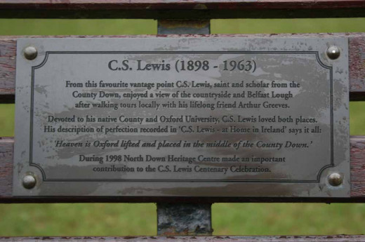 A plaque on a park-bench
