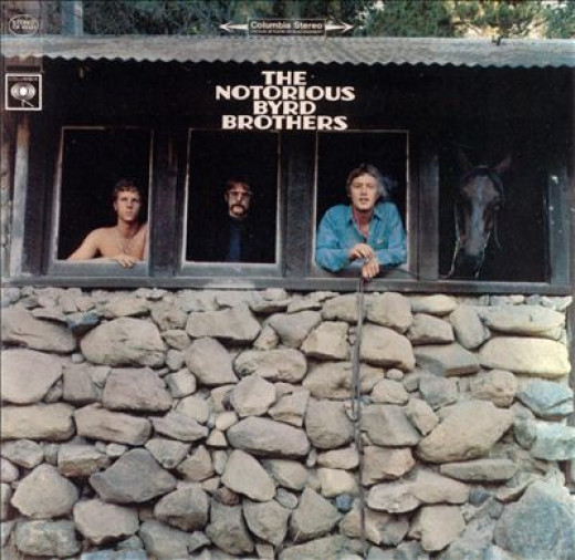 The cover photo of the Notorious Byrd Brothers album. Shown, from left to right: Chris Hillman, Roger McGuinn, Michael Clarke... and NOT David Crosby