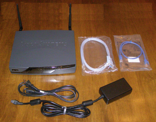 Make sure you get a power supply with yours, a console cable is nice too!   I got full power supply, a patch cable, a roll-over cable, and the two antennae, for 115 dollars from eBay.  NEW ONES in the box with plastic go for 155 dollars and up.