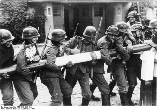 September 1, 1939. German soldiers remove a frontier barrier at the Zoppot (Sopot) – Gdingen (Gdynia) road, close to Danzig.