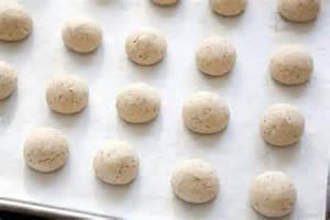 rolled balls on parchment paper ready to be baked
