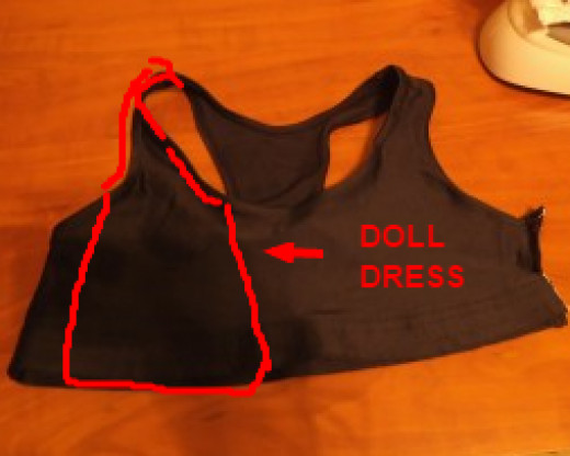 This shows the part of the bra used for the front of the dress. Allow extra fabric when cutting, so you have enough to wrap around the back of the doll.