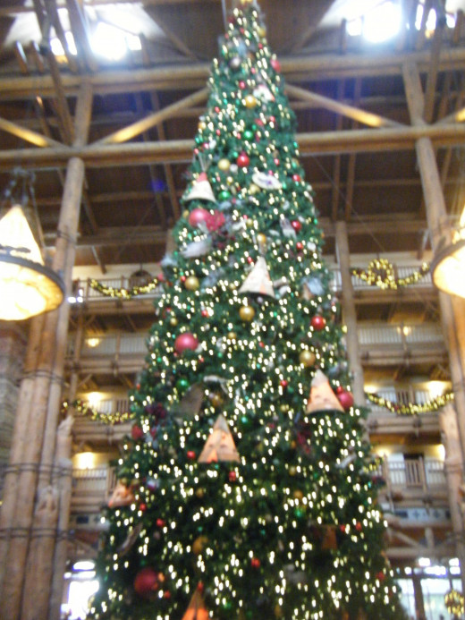 The tree in the lobby at Wilderness Lodge has different animals and Native American themed objects.