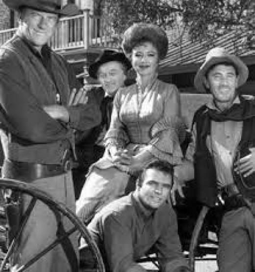 CAST OF GUNSMOKE (from left) James Arness; Milburn Stone; Amanda Blake; Ken Curtis and Burt Reynolds, sitting