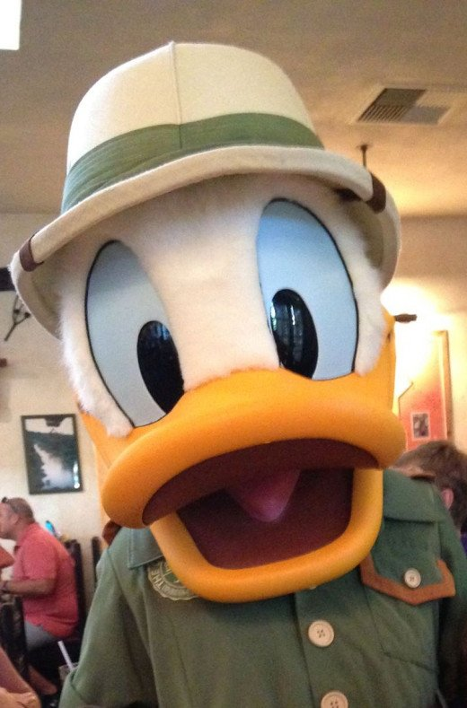 Tusker House has classic Disney characters in safari outfits present in the dining room at breakfast, lunch, and dinner.