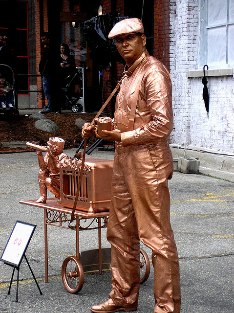 A street performer in Grand rapids Michigan. The Bronze Man.