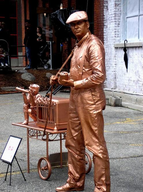 A street performer in Grand rapids Michigan. The Bronze Man.