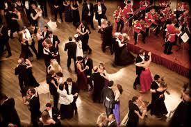Crowds fill a ballroom