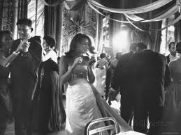 a young girl learns how to be a graceful socialite at a New York ball