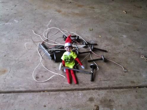 Elfie the safety elf helping to install garage door rollers.