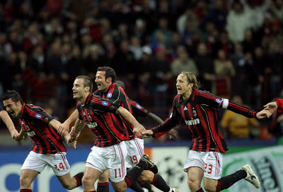 AC Milan players celebrate after defeating Manchester United 3-0 to reach the 2007 UEFA Champions League final.