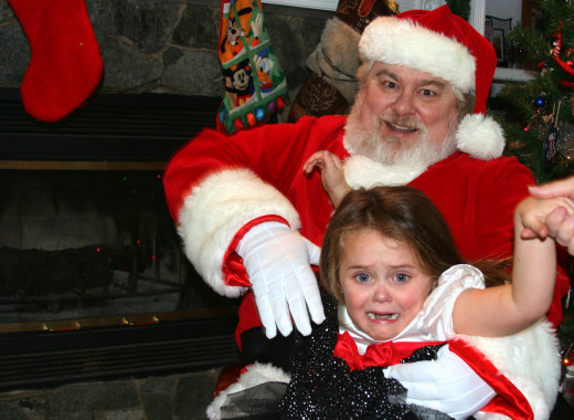 This poor girl obviously has issues with Santa too!