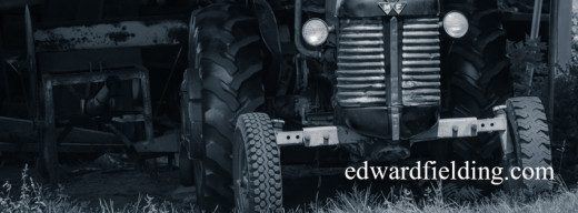 An old tractor in an old New England barn.  Fine art photography by Edward M. Fielding