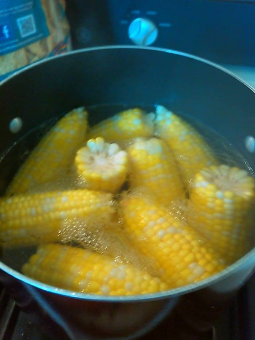 Corn on the cob.  Boil then rub them on heavily buttered bread and sprinkle with salt.