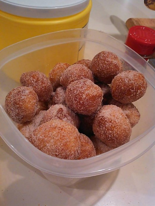 Can of biscuit dough broken into balls and fried until brown (very short cook time).  Then dunk them in chocolate or a sugar mixture.  (Don't use baking soda that was mislabeled as powdered sugar...)