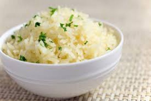 Here we have a bowl of hot buttered rice topped with fine diced chopped parsley.