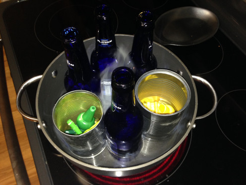 Cans (and bottles) go in a boiling water bath.