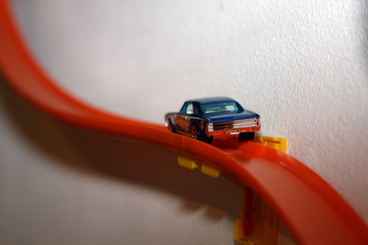Hot Wheels car on orange plastic track
