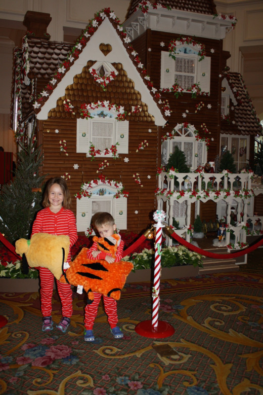 The kids pose in front of the Gingerbread House in the lobby of the Grand Floridian