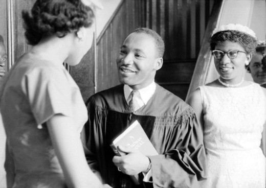 The Reverend speaks with people after delivering a sermon in 1956.