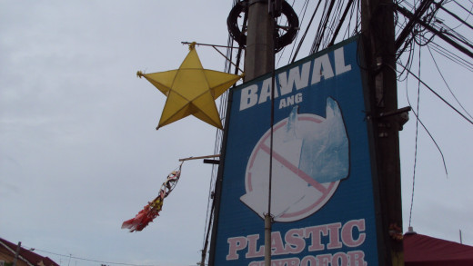 A plastic lantern in the shape of a star hangs right beside a sign that prohibits plastics in the town of Calumpit.