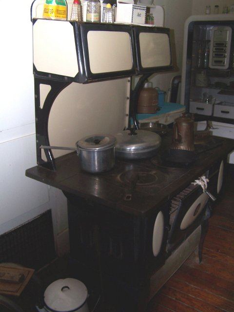 This old stove is very similar to the one my Mama used.  Mama kept biscuits in the top part to keep them nice and warm for me.