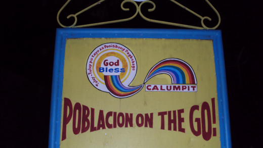 "The Land of True Love. The logo of Calumpit town is a deformed, twisted rainbow. It is a first-class municipality. (Written in Tagalog are the words ""We are all continually nearing our goal of positive change."")"
