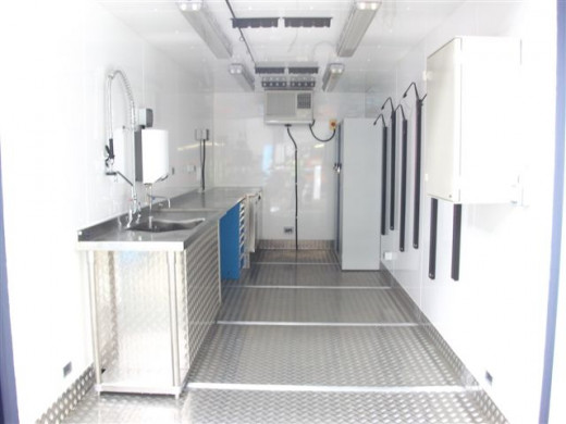 This unit has been converted into what looks like a kitchen space, there is ample room to add a fold up table and chairs and double it up as a dining space too. If you had a bed, you could have it as a sleeping area; a self contained bedsit.