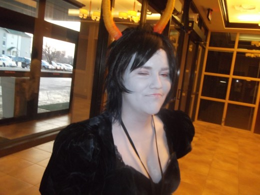 Myself cosplaying Kanaya at Arkansas Anime Festival wearing Mehron CremeBlend Stick. Horns have a tin-foil base with yarn wrapped and painted outside.