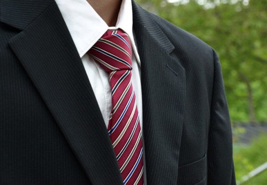 A tie is a classic last minute idea. This design has some red, blue, yellow, and white a more fun choice to the classic tie patterns and colors. This makes it more likely that the receiver doesn't already own a tie like this.