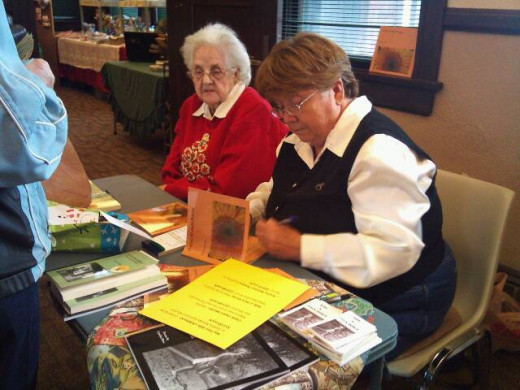 Ross and her mother holding a joint- booksigning.
