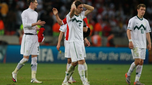 Marko Suler (4) and Valter Birsa (10) leave dejected after Slovenia lost 1-0 to England in Port Elizabeth, South Africa on June 23, 2010